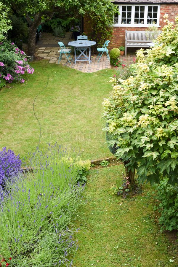 A well kept back yard or garden with lawn and seating area, high angle shot. Outside royalty free stock photos