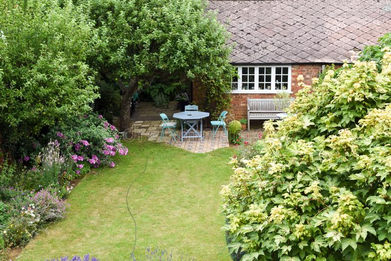 A well kept back yard or garden with lawn and seating area, high angle shot. Outside stock photos