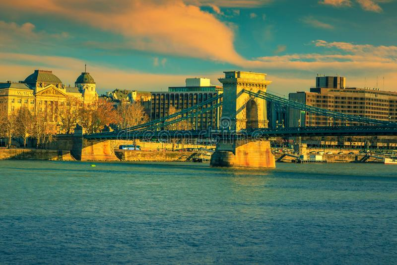 Famous Chain bridge with hotels at sunset, Budapest, Hungary stock photography