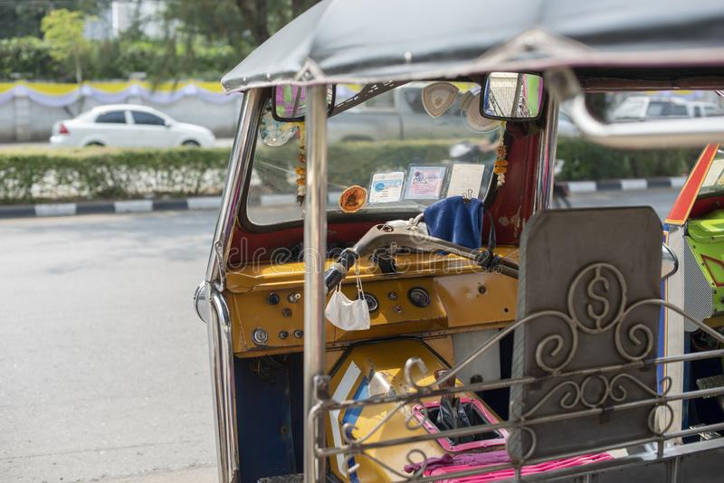 Well known and famous local taxi in Thailand, Tuk-Tuk, parking nearby tourist place, waiting for passengers asking for a ride. Image showing lots of details of stock photos
