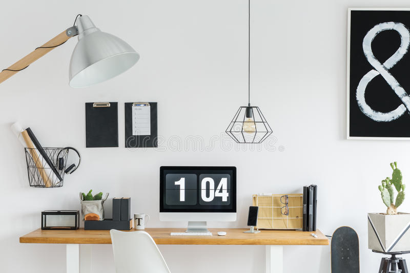 Well organized desk. Well organized wooden desk in black and white home office royalty free stock photography