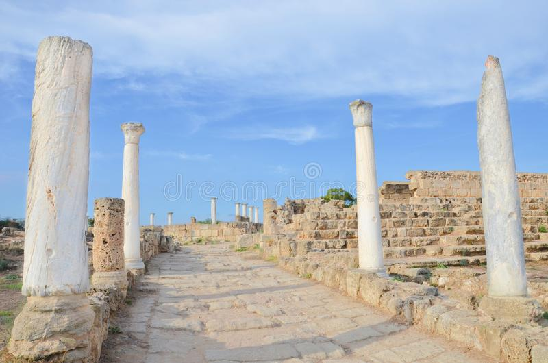 Well preserved ancient Corinthian columns with wall ruins with blue sky above. The ruins were part of famous Salamis Gymnasium royalty free stock photos
