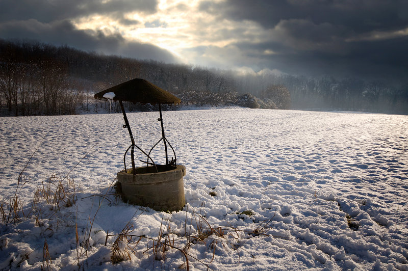 Well In Snow Land Stock Photos