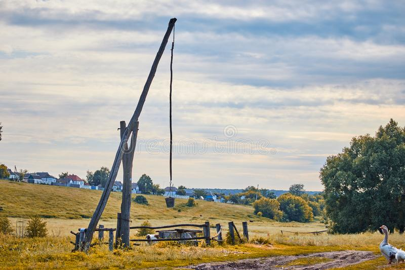 A well with a special lifting mechanism called a crane stock image
