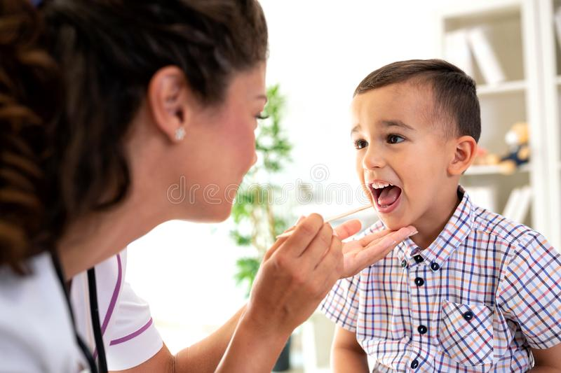 Well trained physician checking the throat royalty free stock image