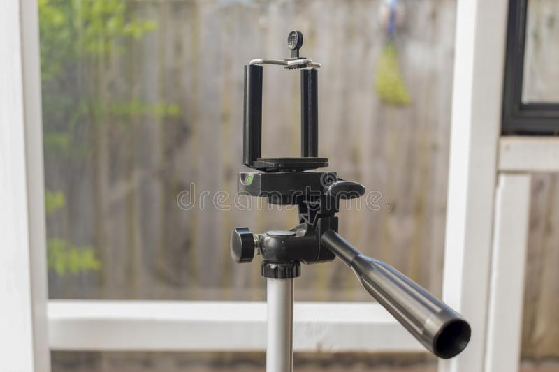 Well used mobile phone tripod stock photo