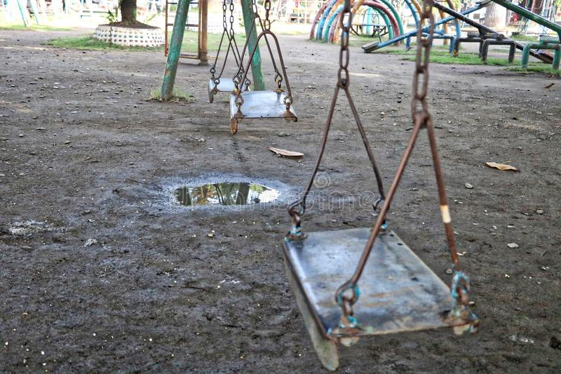 Old style  Vintage  playground Swings royalty free stock photos
