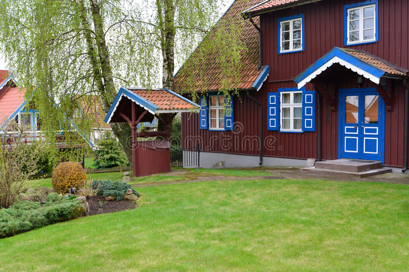 Well in a yard of the rural house. Nida, Lithuania.  royalty free stock photo
