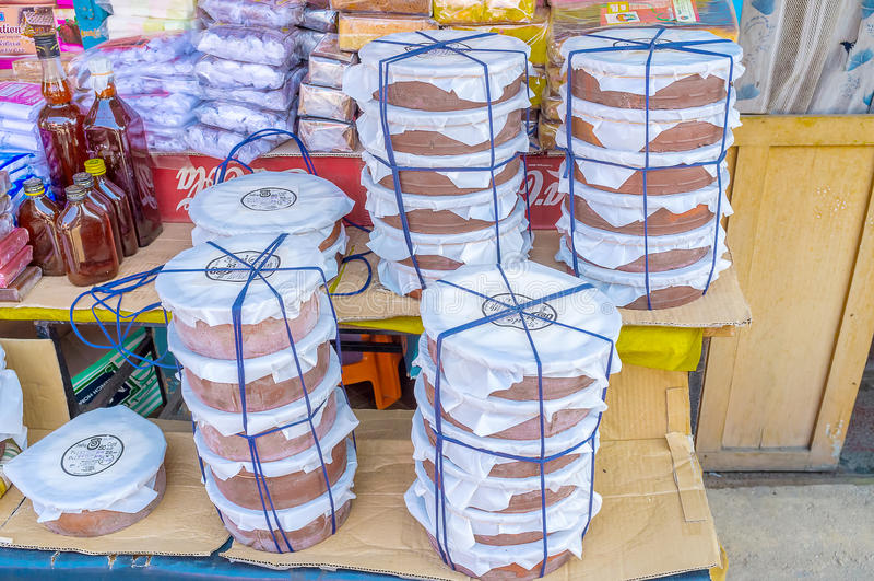 Stacks of curd jars in Sri Lanka. WELLAWAYA, SRI LANKA - DECEMBER 2, 2016: The view on stacks of containers of curd - popular Sri Lankan fermented milk product stock image