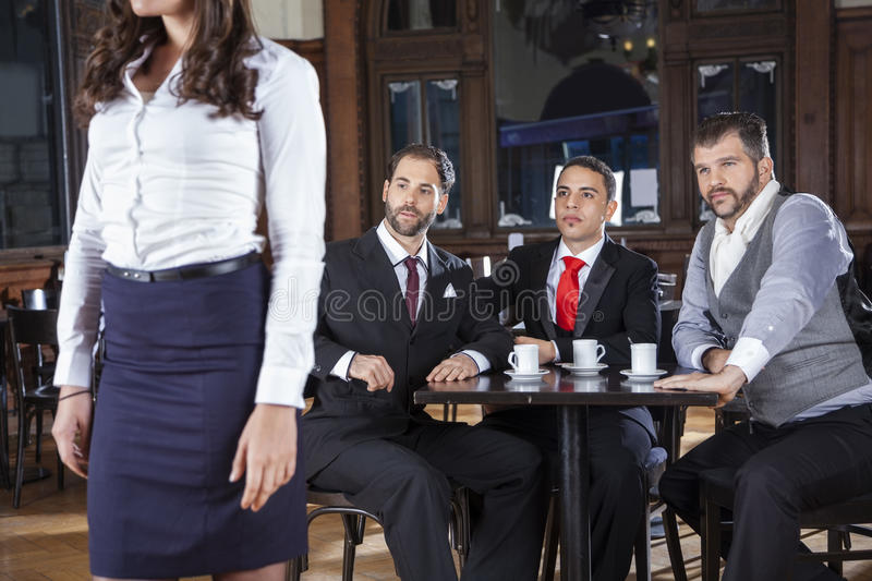 Welldressed Pervert Friends Looking At Tango Dancer. Welldressed pervert male friends looking at female tango dancer in restaurant royalty free stock photography