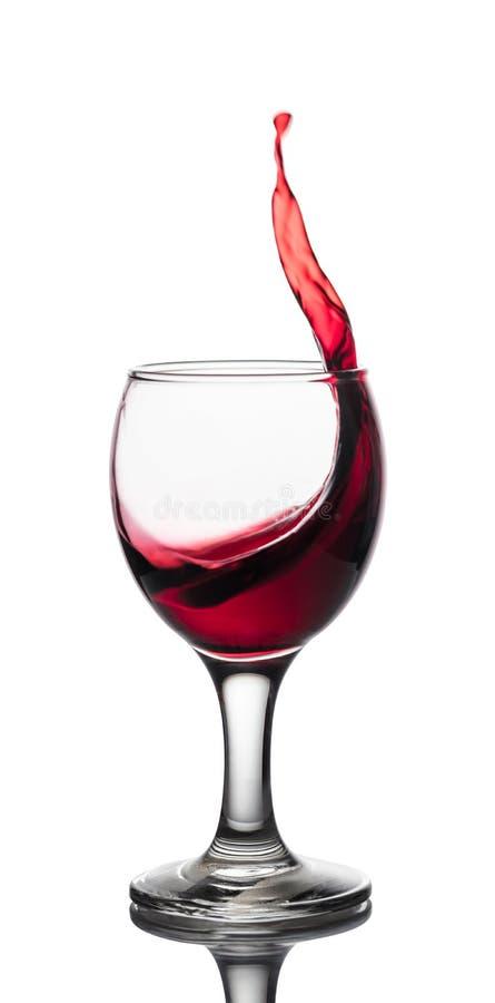 Welle des Rotweins in einem Glas stockfotografie