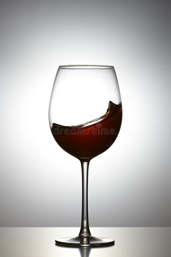 Welle in einem Weinglas lizenzfreie stockfotos