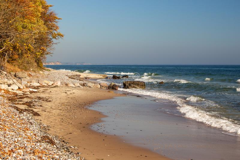 Lonesome beach with waves at the coast of Moen an island in Denmark stock image