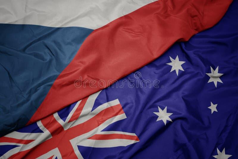 wellenartig bewegende bunte Flagge von Australien und Staatsflagge der Tschechischen Republik lizenzfreie stockbilder
