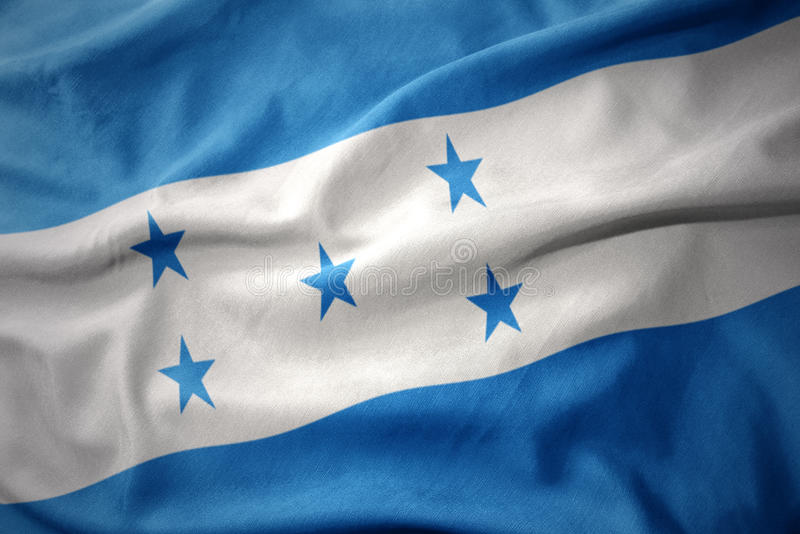 Wellenartig bewegende bunte Flagge von Honduras lizenzfreies stockbild
