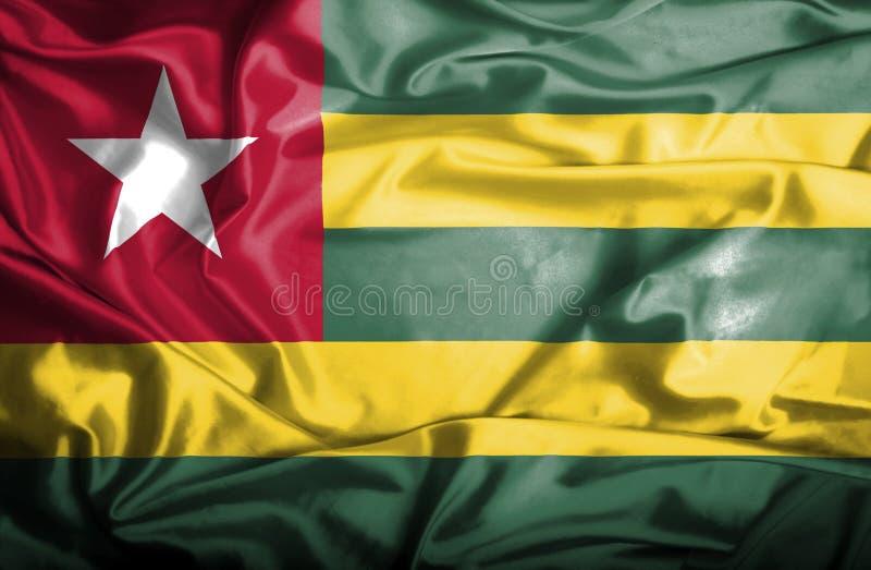 Wellenartig bewegende Flagge Togos vektor abbildung