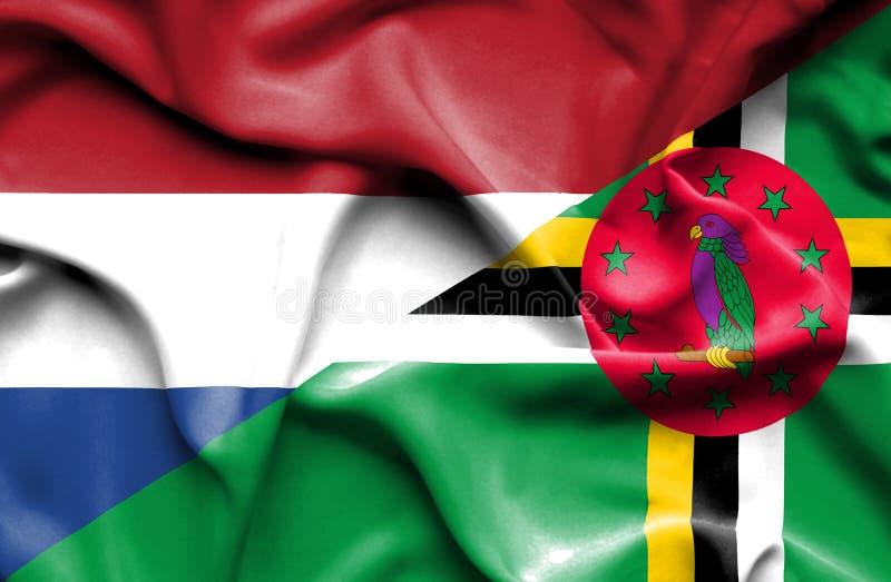 Wellenartig bewegende Flagge von Dominica und von Niederlanden stock abbildung