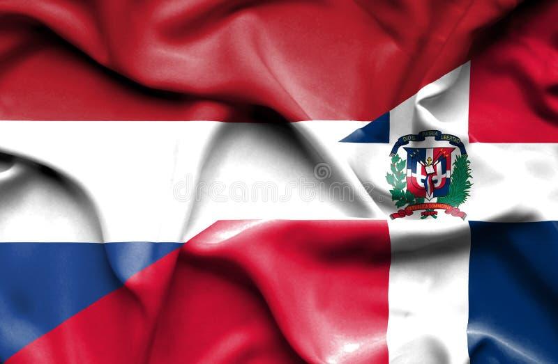 Wellenartig bewegende Flagge von Dominikanischer Republik und von Niederlanden stock abbildung