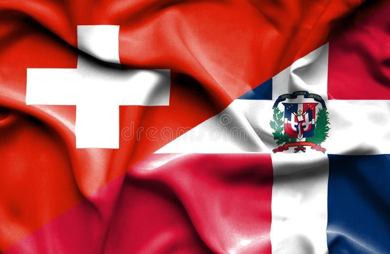 Wellenartig bewegende Flagge von Dominikanischer Republik und von Schweiz lizenzfreie abbildung