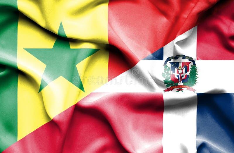 Wellenartig bewegende Flagge von Dominikanischer Republik und von Senegal lizenzfreie abbildung