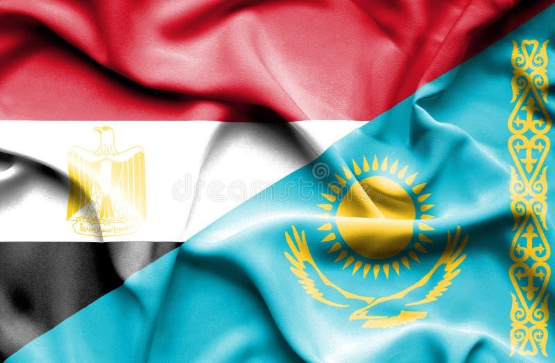 Wellenartig bewegende Flagge von Kasachstan und von Ägypten stockfotos
