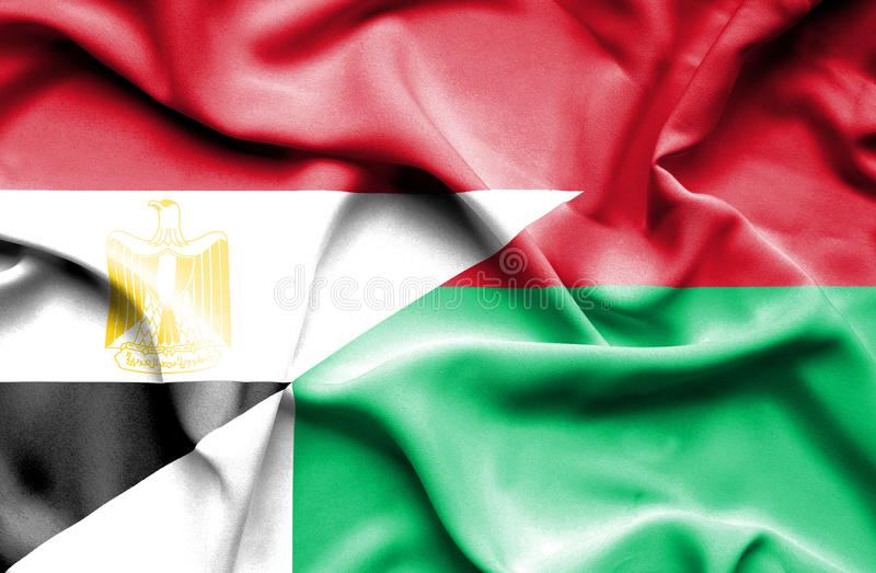 Wellenartig bewegende Flagge von Madagaskar und von Ägypten lizenzfreies stockbild
