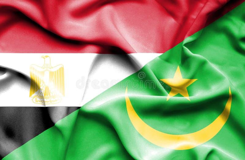 Wellenartig bewegende Flagge von Mauretanien und von Ägypten lizenzfreie stockbilder