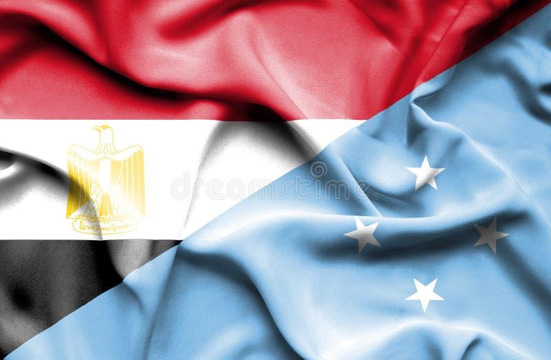 Wellenartig bewegende Flagge von Mikronesien und von Ägypten stockbilder