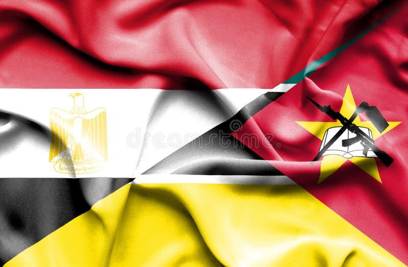 Wellenartig bewegende Flagge von Mosambik und von Ägypten lizenzfreies stockbild