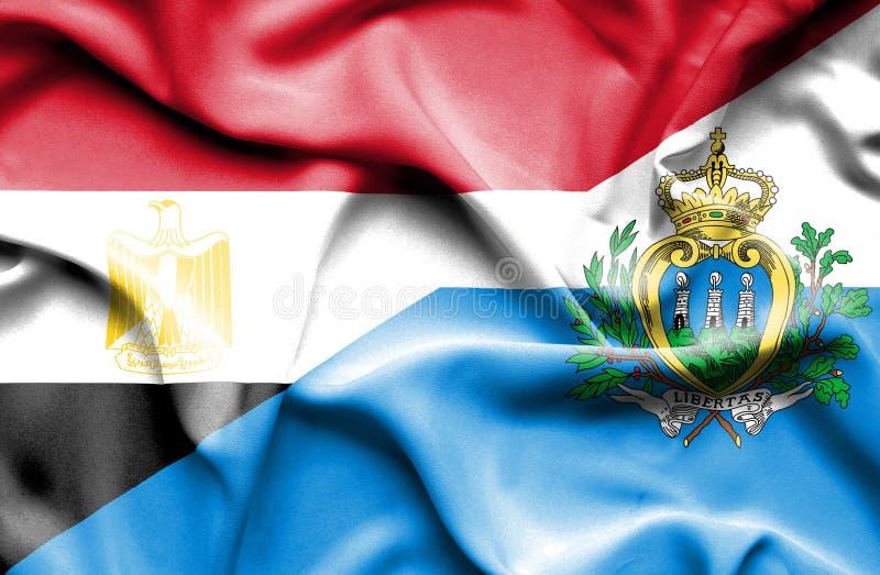 Wellenartig bewegende Flagge von San Marino und von Ägypten lizenzfreies stockfoto