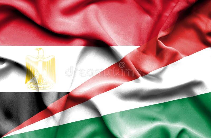 Wellenartig bewegende Flagge von Seychellen und von Ägypten stockfotos