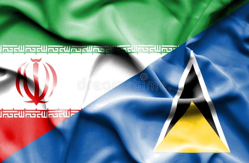 Wellenartig bewegende Flagge von St Lucia und von Iran lizenzfreie abbildung