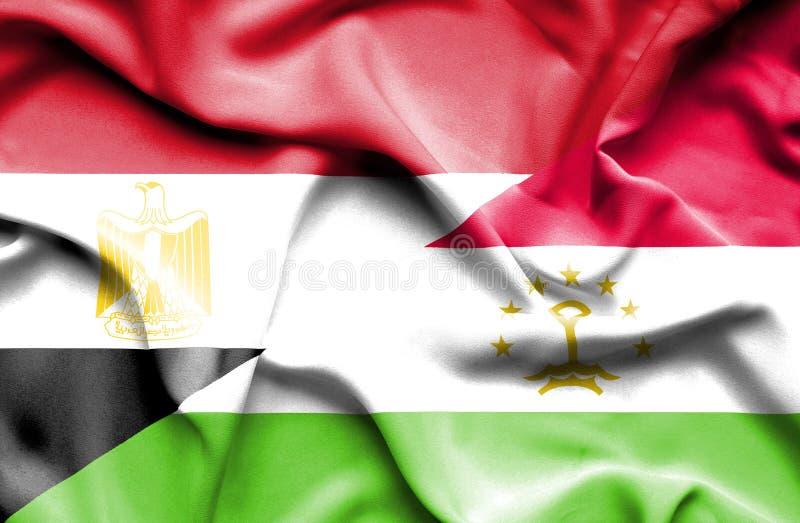 Wellenartig bewegende Flagge von Tadschikistan und von Ägypten lizenzfreies stockfoto