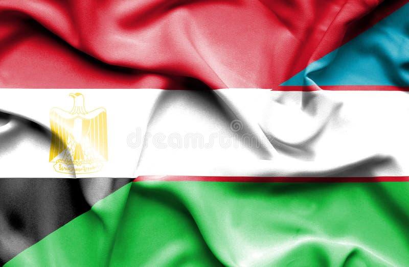 Wellenartig bewegende Flagge von Usbekistan und von Ägypten lizenzfreies stockfoto