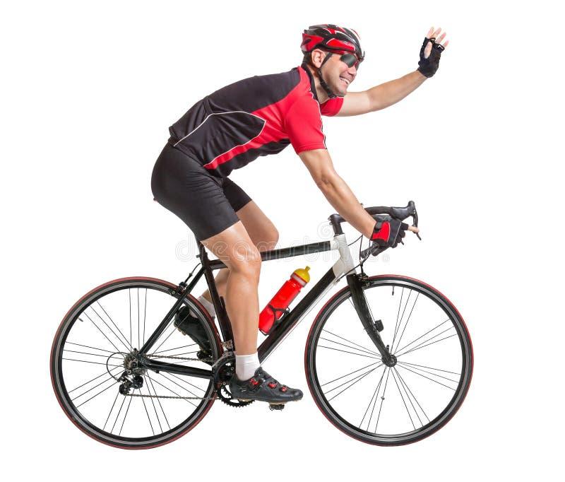 Wellenartig bewegende Hände des Radfahrers und Fahren Fahrrads lizenzfreie stockfotos