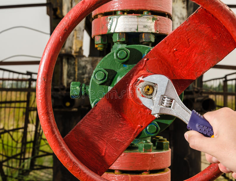 Wellhead valve repair with the wrench stock image