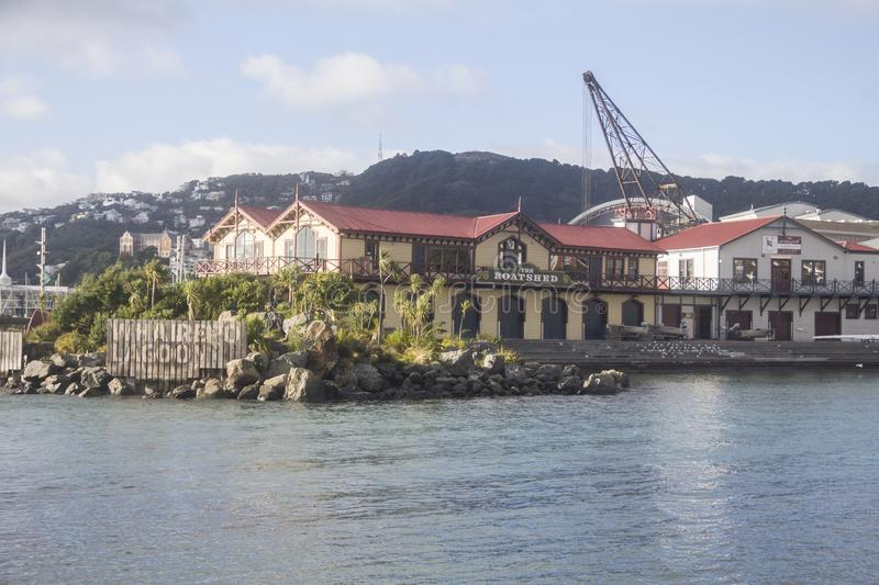 Wellington, New Zealand Harbor. A rocky wharf with a restaurant or hotel in Wellington, New Zealand`s harbor royalty free stock photography