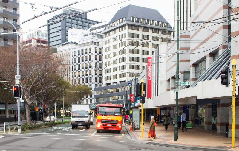 Pedestrians and vehicles going about their day in downtown Wellington stock photos