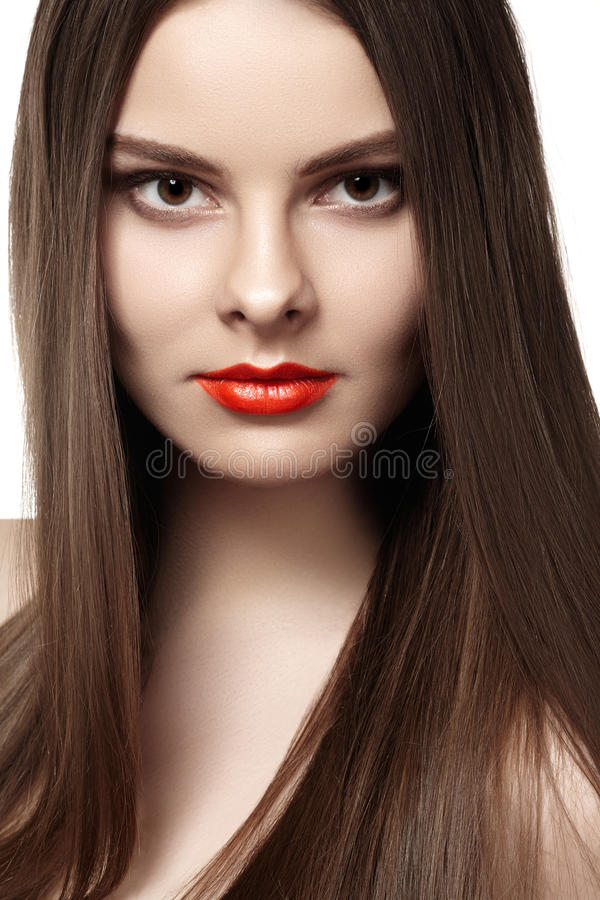 Wellness. Ð¡osmetics. Woman with shiny long hair. Wellness. Ð¡osmetics. Portrait of woman with shiny long brown hair on gray background stock photo
