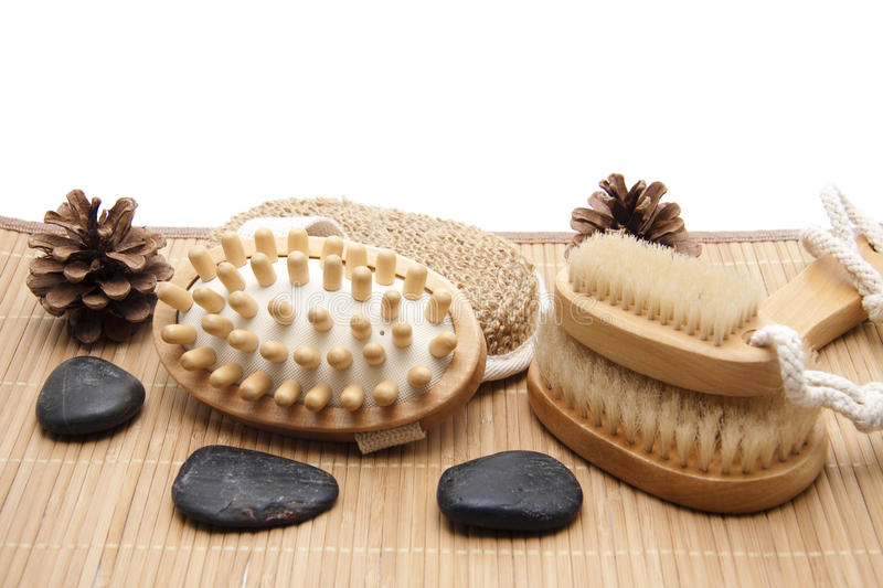 Wellness accessories. Massage brush and nailbrush with sponge and pine cone royalty free stock photo