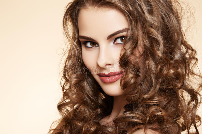 Wellness. Beautiful model with long curly hair royalty free stock photos