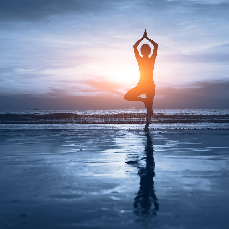 Wellness concept, blue backgrounf. Wellness concept, beautiful silhouette of woman practicing yoga stock image