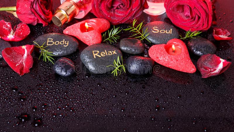 Wellness decoration, Spa concept in Valentine& x27;s Day. Spa concept in Valentine& x27;s Day, red roses, candles in the shape of heart, black therapy stones royalty free stock photos