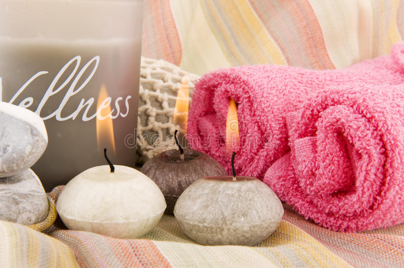 Wellness in gray and pink. With burning candles stock image