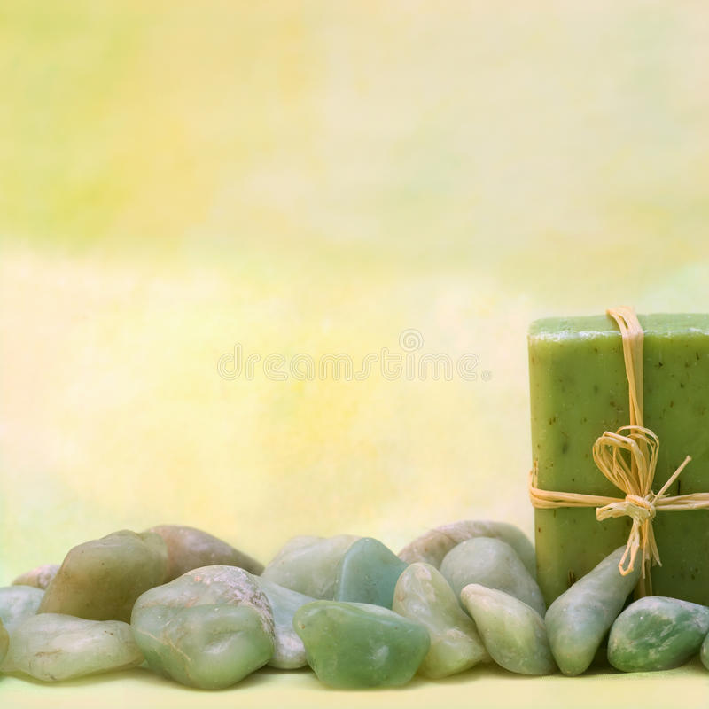 Wellness with herbal soap and stones. Background of wellness products with herbal soap and stones royalty free stock photo