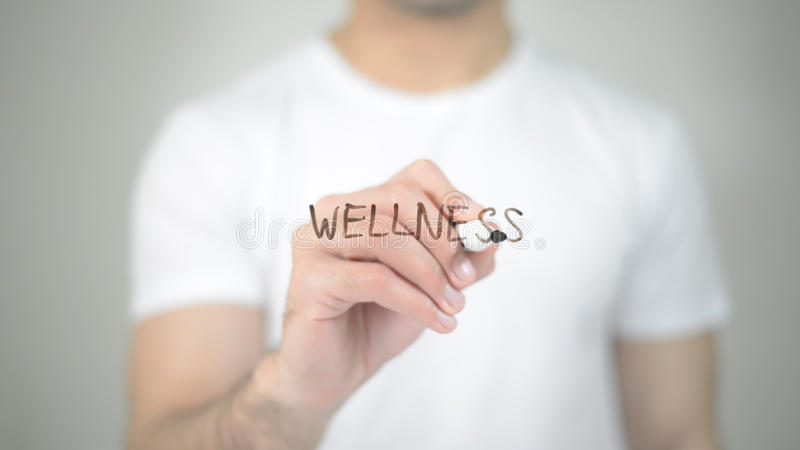 Wellness, man writing on transparent screen. High quality royalty free stock photo