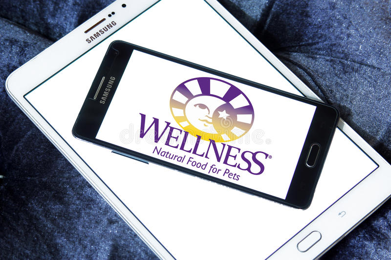 Wellness pet food logo. Logo of wellness pet food company on samsung mobile on samsung tablet royalty free stock images