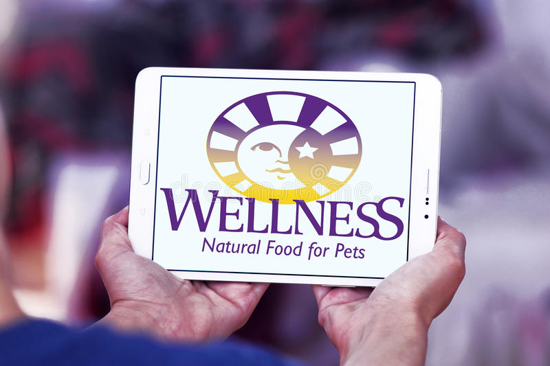 Wellness pet food logo. Logo of wellness pet food company on samsung tablet stock images