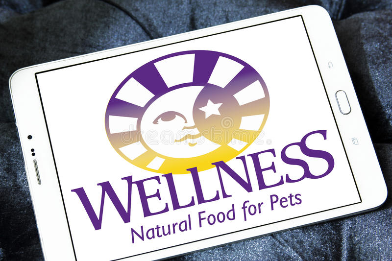 Wellness pet food logo. Logo of wellness pet food company on samsung tablet royalty free stock image