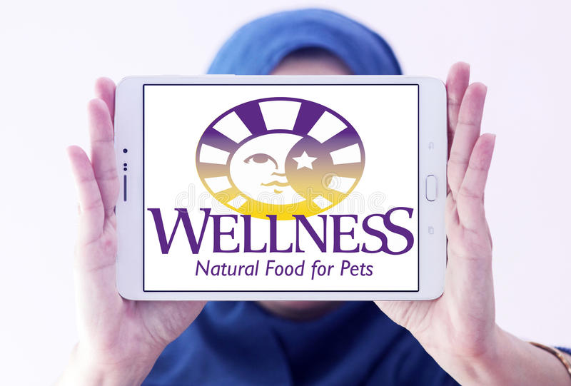 Wellness pet food logo. Logo of wellness pet food company on samsung tablet holded by arab muslim woman royalty free stock images